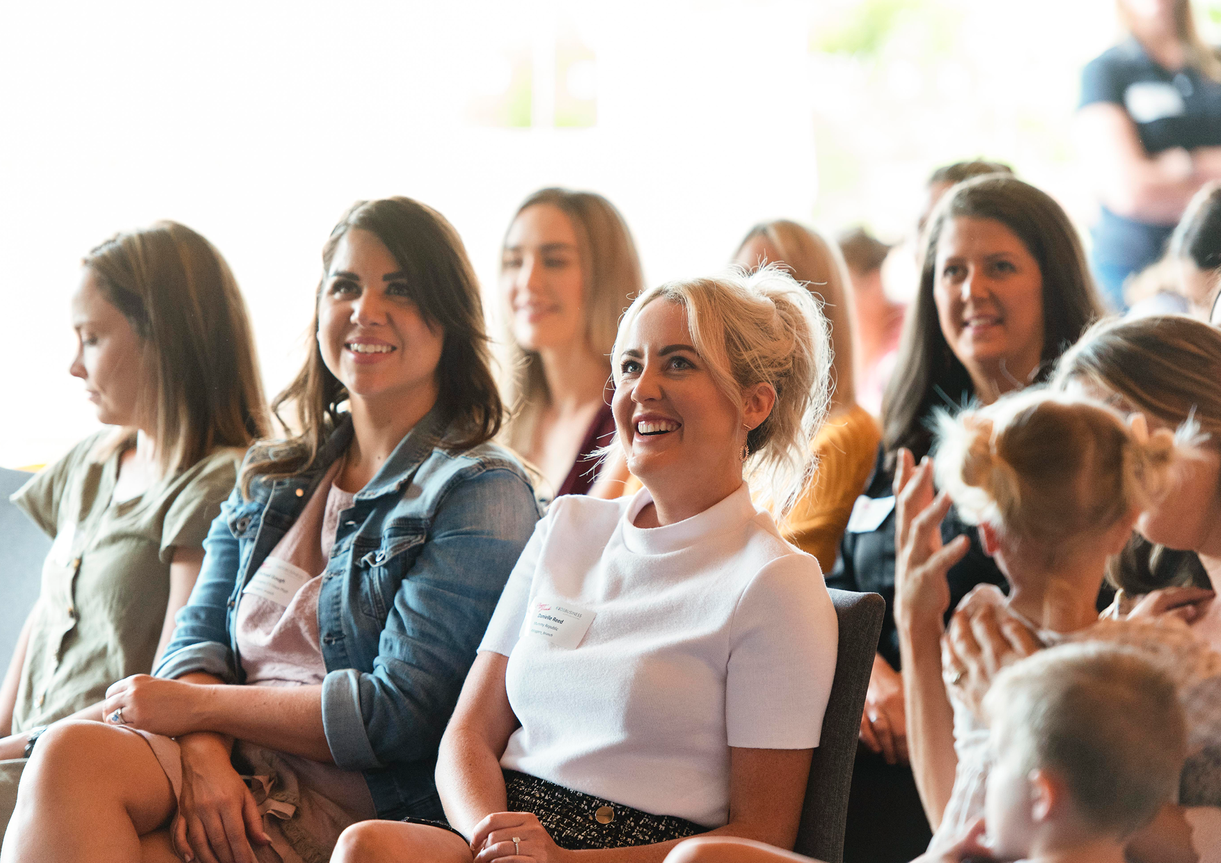 Women influencers sitting down, smiling & enjoying q&a